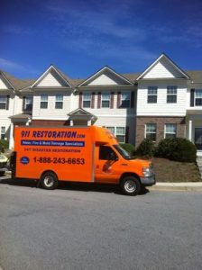 Disaster Restoration Truck At Townhouse