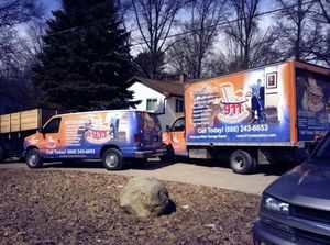 Commercial Property Damage Restoration Fleet At Job Site