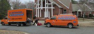 Snow Storm Damage Repair Vehicles At Job Site