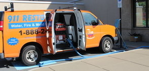 Water Damage and Mold Removal Van At Job Site